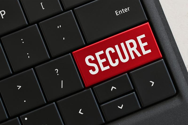 """Imagen de tecla de ordenador con la palabra """"secure"""", seguridad en inglés"""